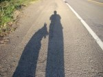 Shadows of Dante dog and me on the road.