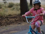 Willow grins from ear to ear as she masters riding the bike with no training wheels.