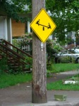 I don't think putting a sign on a telephone pole makes it a teeter totter.  :)