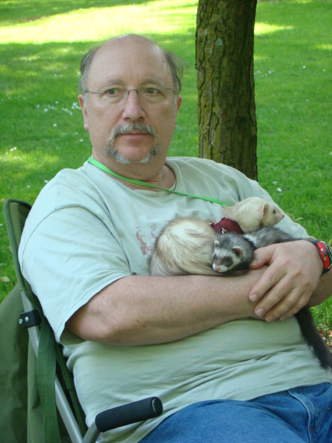 My dad holding a couple of his Littles.  The blonde one is Sage, who is the mellowest one of the bunch.  He acts like he's stoned, he's so mellow.