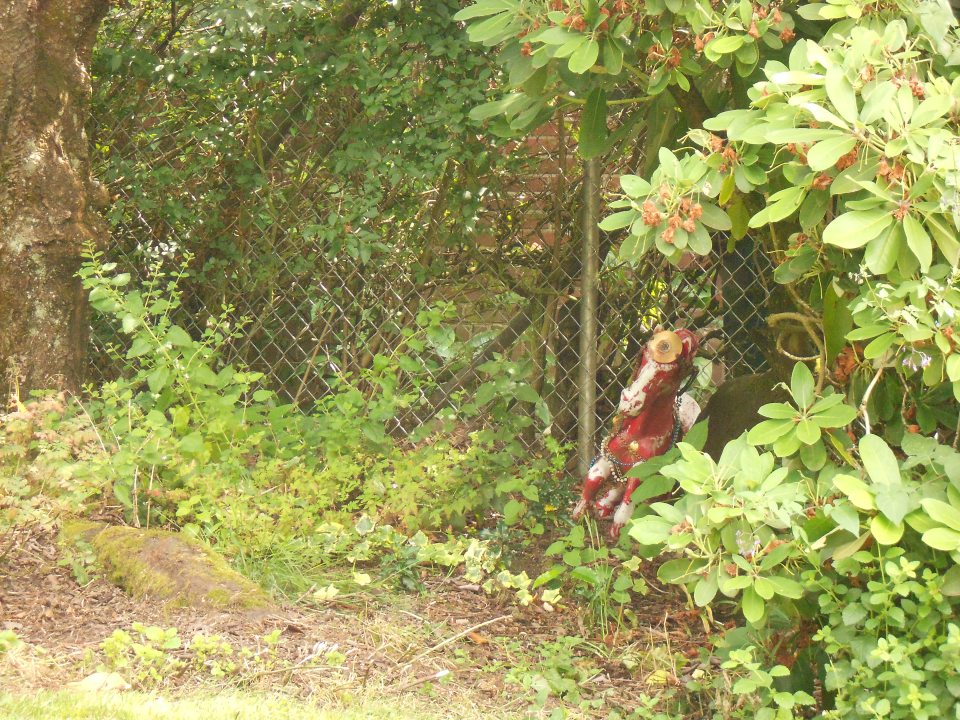 A springy little hobby horse hiding in somebody's front yard.