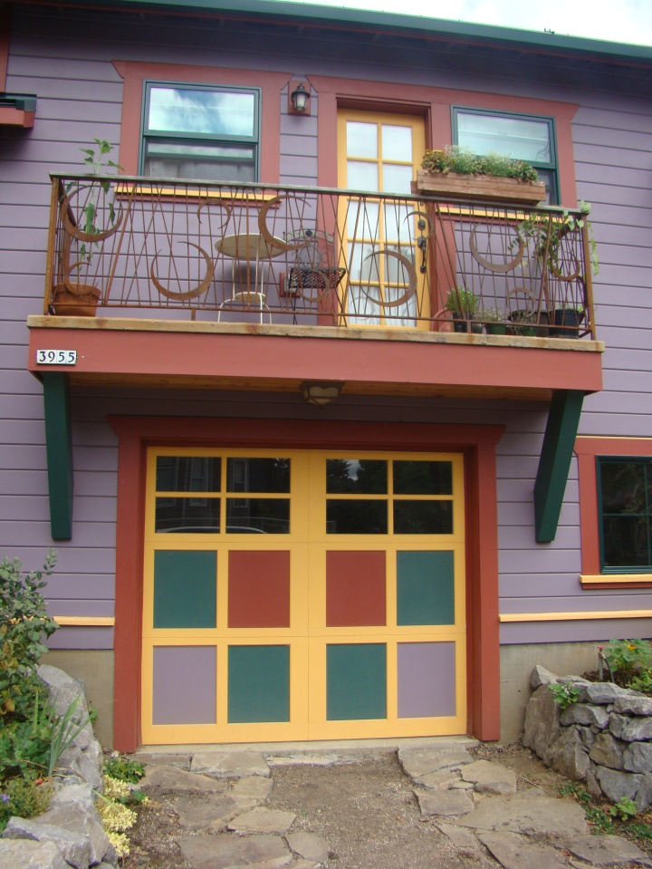 This house had a brightly colored garage, and I like the balcony railing.
